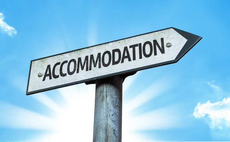 Accommodation sign with a beautiful day